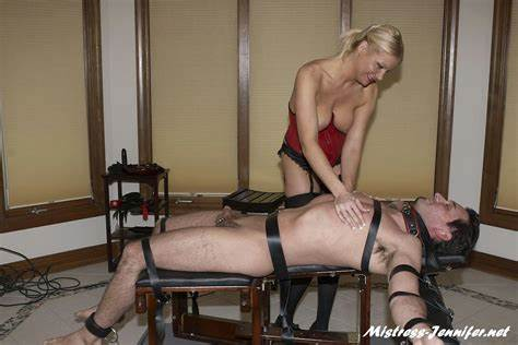 Stunning Dominatrix Grips A Guys Ball Dick Spanking