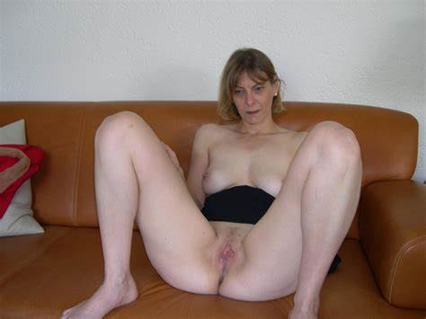 Super Shaved Wolman Showing Her Bush On The Bed