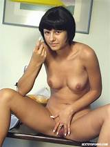 A young brunette babe toying pussy