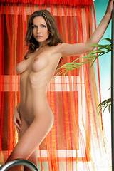 Busty brunette dancing topless