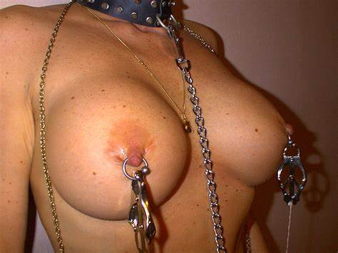 Chained Slave With Asian Pierced Titties