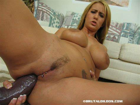 Lady Toying Her Snatch With Large Vibrator