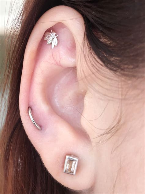 Fresh lobe orbital piercing and a week old helix : piercing