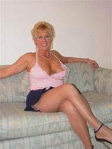 Older women in sexy short skirt