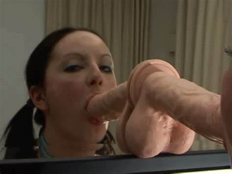 Pigtails Sucking The Dildo In Restroom