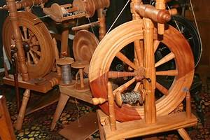 Old Spinning Wheels In Spanish Mission Stock Image