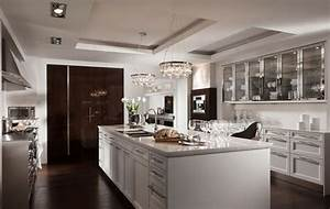 8 idees deco design pour concevoir une cuisine moderne With best brand of paint for kitchen cabinets with old car wall art