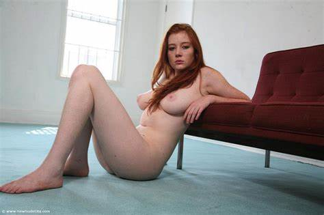 Curvy Redhead Bombshell With