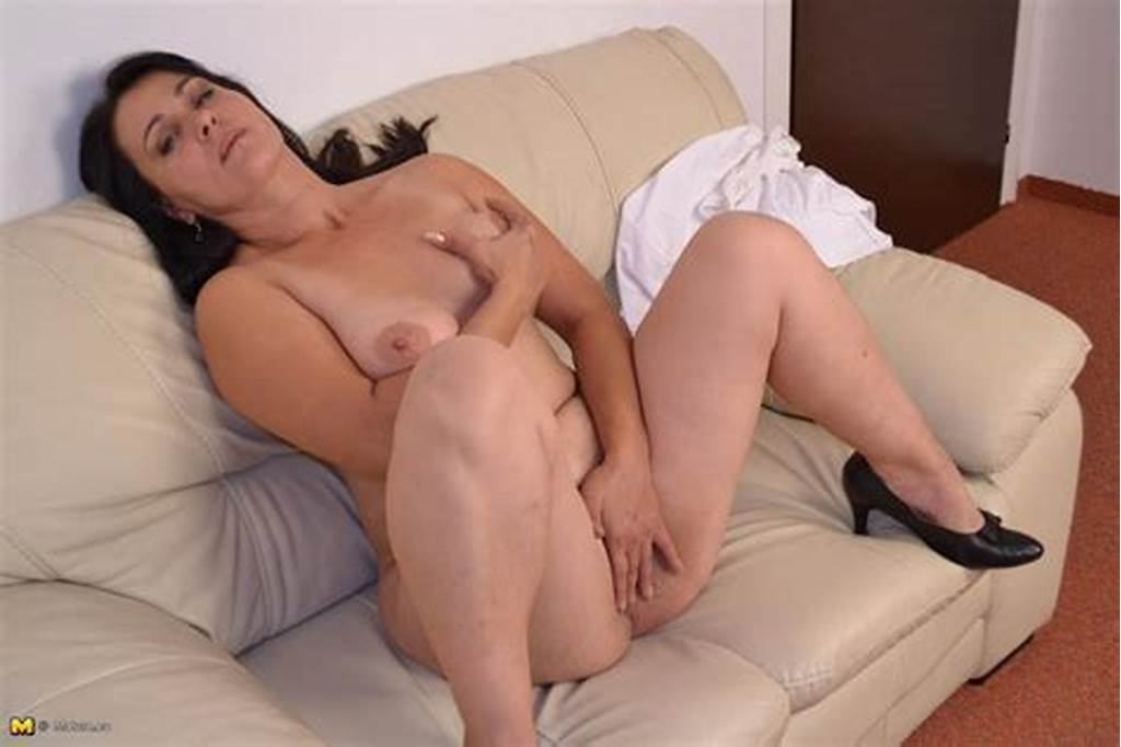 #Horny #Mature #Slut #Playing #With #Herself #On #The #Couch