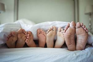 Family, Feet, Sticking, Out, From, Under, The, Bed, Sheet