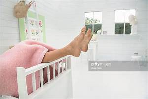 Childs, Feet, Sticking, Out, From, Bed, High-res, Stock, Photo