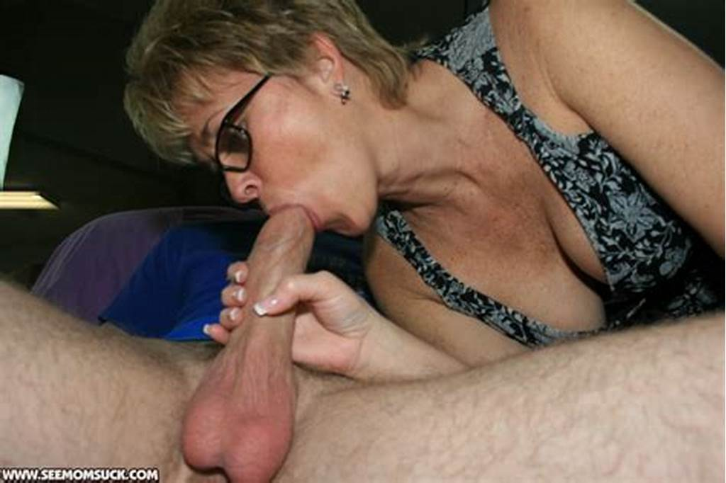 #Short #Haired #Mature #Blonde #In #Glasses #Gives #A #Sensual