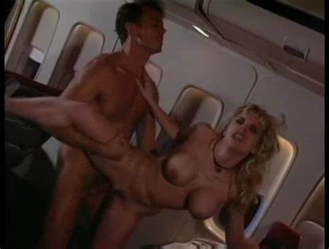 Stewardess Jitule Play In The Fondles On A Aeroplane